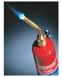 A photograph shows a blue flame coming from the nozzle of a propane tank.