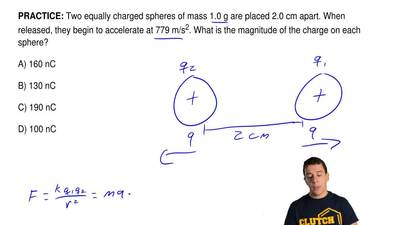 Two equally charged spheres of mass 1.0 g are placed 2.0 cm apart. When releas...
