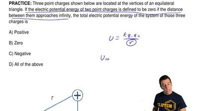Three point charges shown below are located at the vertices of an equilateral ...