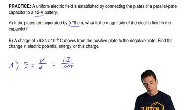 A uniform electric field is established by connecting the plates of a parallel...