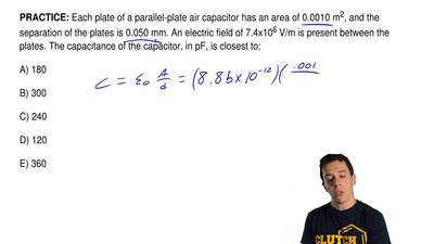 Each plate of a parallel-plate air capacitor has an area of 0.0010 m 2, and th...