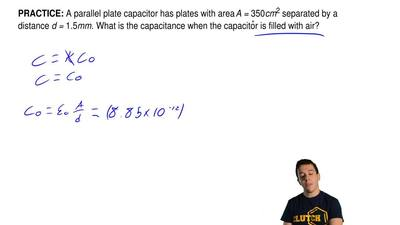 A parallel plate capacitor has plates with area A = 350cm2 separated by a dist...