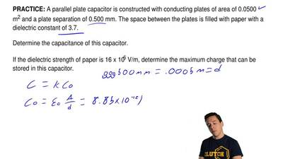 A parallel plate capacitor is constructed with conducting plates of area of 0....