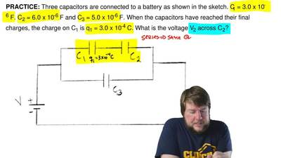 Three capacitors are arranged as shown below. C1 = 3.0 x 10-6 F. C2 = 6.0 x 10...