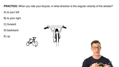 When you ride your bicycle, in what direction is the angular velocity of the w...