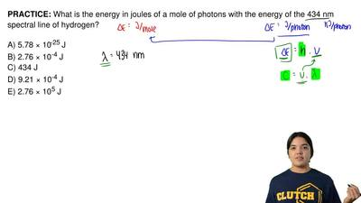 What is the energy in joules of a mole of photons with the energy of the 434 n...