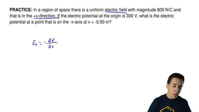 In a region of space there is a uniform electric field with magnitude 800 N/C ...