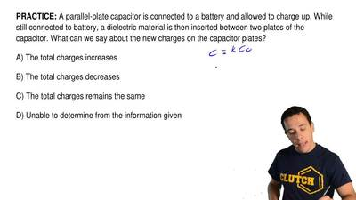 A parallel-plate capacitor is connected to a battery and allowed to charge up....