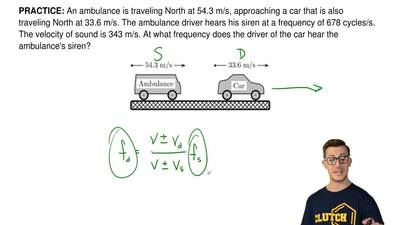 An ambulance is traveling North at 54.3 m/s, approaching a car that is also tr...