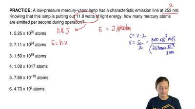 A low-pressure mercury-vapor lamp has a characteristic emission line at 253 nm...