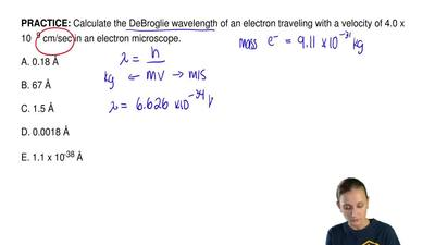 Calculate the DeBroglie wavelength of an electron traveling with a velocity of...