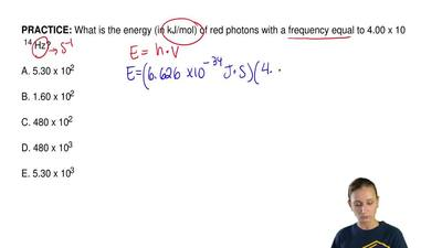 What is the energy (in kJ/mol) of red photons with a frequency equal to 4.00 x...