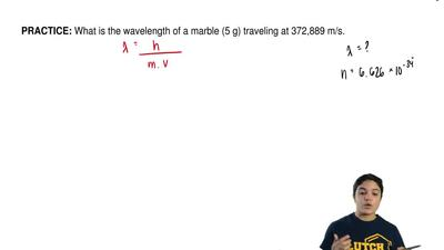 What is the wavelength of a marble (5 g) traveling at 372,889 m/s. ...