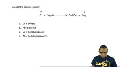 Consider the following reaction:  Cu + 2 AgNO3 → Cu(NO3)2 + 2 Ag     a. Cu is ...