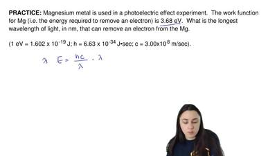 Magnesium metal is used in a photoelectric effect experiment.  The work functi...